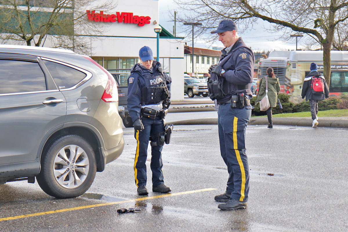 Langley RCMP surround the gun, which was determined to be a replica, where it was found at the Langley Centre bus station. (Sarah Grochowski photo)