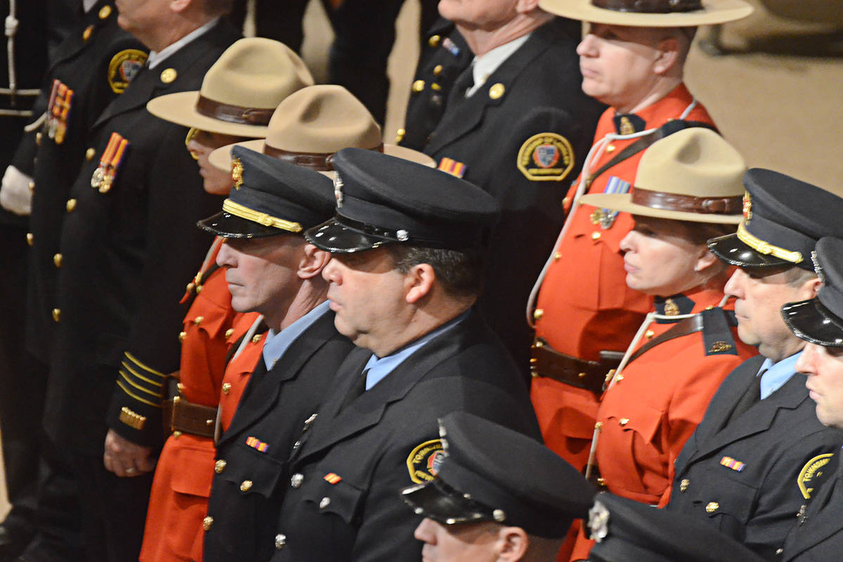 An honour guard of Township firefighters and Langley RCMP officers led in the family of the late Debbie Froese on Jan. 23. (Matthew Claxton/Langley Advance Times)