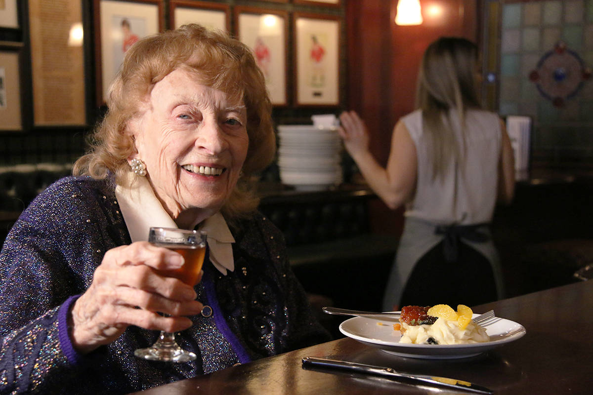 Constance Isherwood raises her glass of sherry at her 100th birthday party on Thursday at the Penny Farthing Public House in Oak Bay. (Kendra Crighton/News Staff)