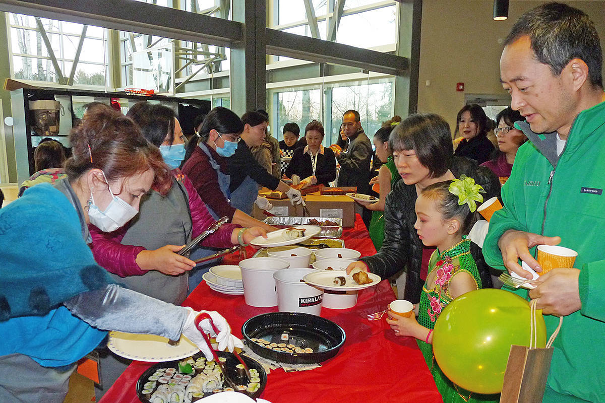 Visitors to the annual Live In Langley Lunar New Year celebration sampled tasty treats at the 2018 event. Organizers, citing rising concern about the coronavirus outbreak in China, called off the Saturday Jan. 25 event. (Langley Advance Times/file)