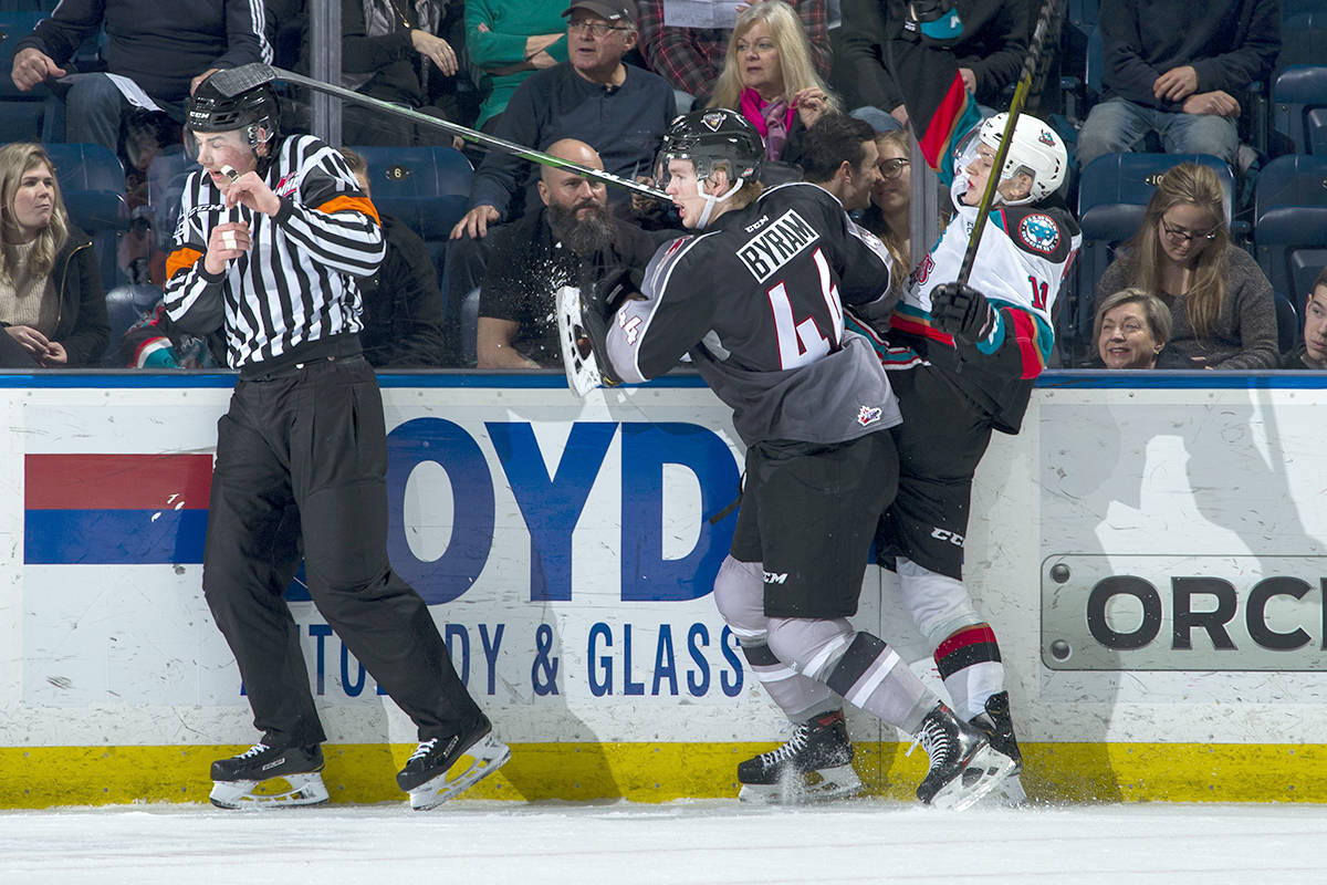 Giants defenceman Bowen Byram checked Pavel Novak of the Kelowna Rockets into the boards during first period play at Prospera Place on Sunday, (Jan. 26) in Kelowna. (Marissa Baecker/Special to Langley Advance Times)