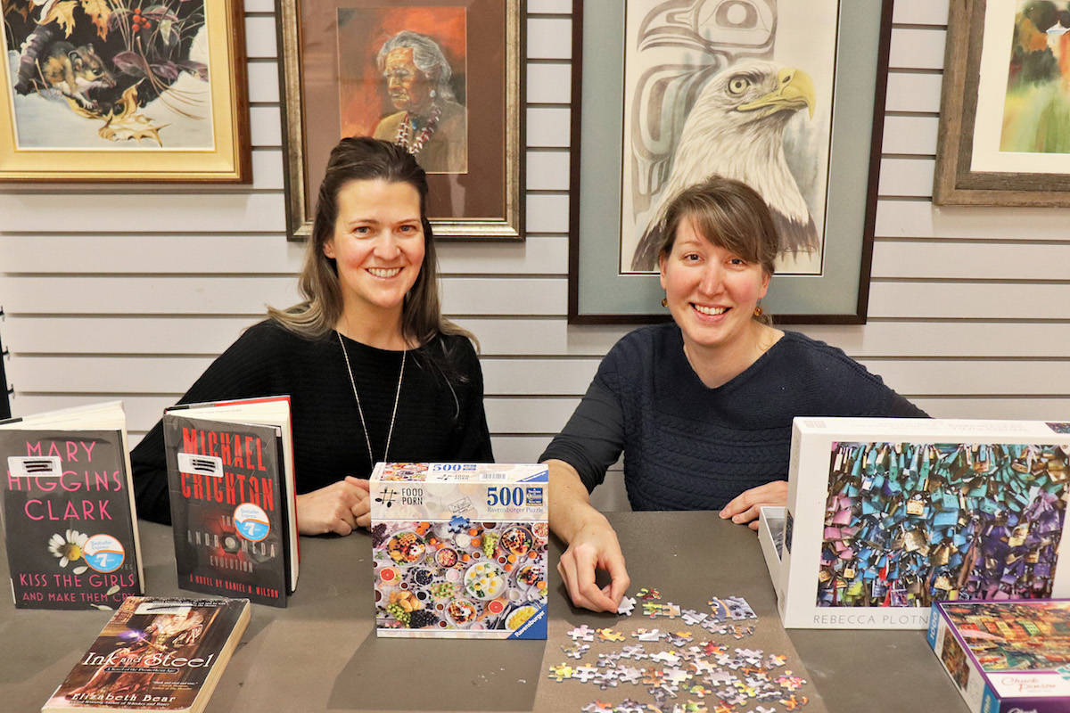 Langley Arts Council coordinator Nicole Hutton (left) and Aldergrove community librarian Jacquelynne Garden (right) have teamed up to host Aldergrove's first-ever Previously Loved Sale on Feb. 28 and 29. (Sarah Grochowski photo)