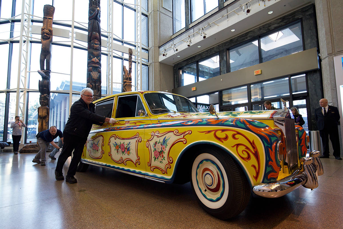 Jan. 27, 2020 – People carefully wheeled in John Lennon's famous Rolls-Royce into the lobby of the Royal BC Museum. (Nicole Crescenzi/News Staff)