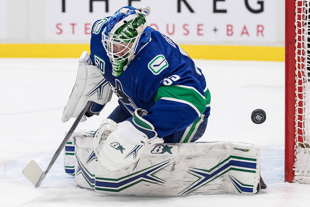 Vancouver Canucks goalie Thatcher Demko stops St. Louis Blues' Zach Sanford during the third period of an NHL hockey game in Vancouver on Monday January 27, 2020. THE CANADIAN PRESS/Darryl Dyck