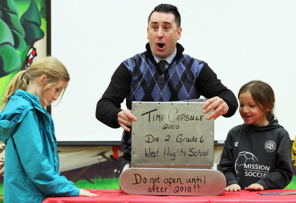 West Heights Community School principal Mikel Brogan reacts in surprise after opening a time capsule that was hidden in the school back in 2000. / Kevin Mills Photos