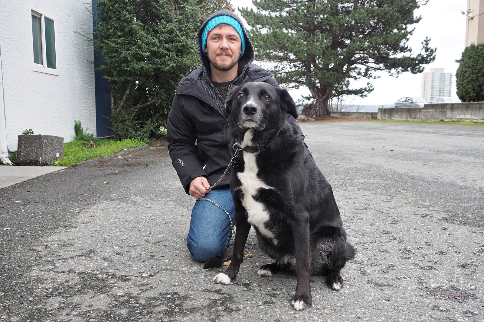 James Olson, Prideaux Street resident in Nanaimo, said he and his dog Max were attacked by a man wearing a cowboy hat, swinging a pole Wednesday. (CHRIS BUSH/The News Bulletin)