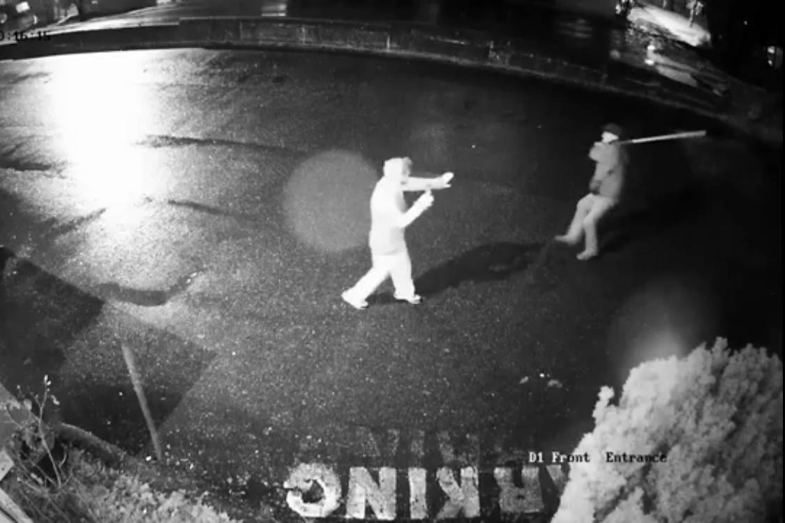 A still from security camera footage from an apartment building on Prideaux Street, in Nanaimo, portrays an alleged attack by a man brandishing a pole Wednesday. The victim said he suffered a concussion and damage to his cell phone. (Photo submitted)