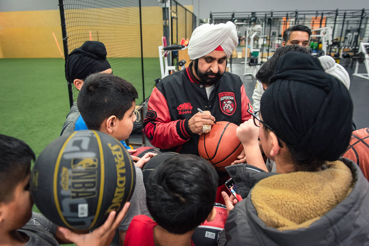Nav Bhatia with young basketball players at the BC Prep gym in Surrey on Jan. 29. (submitted photo: Christopher Edmondstone)
