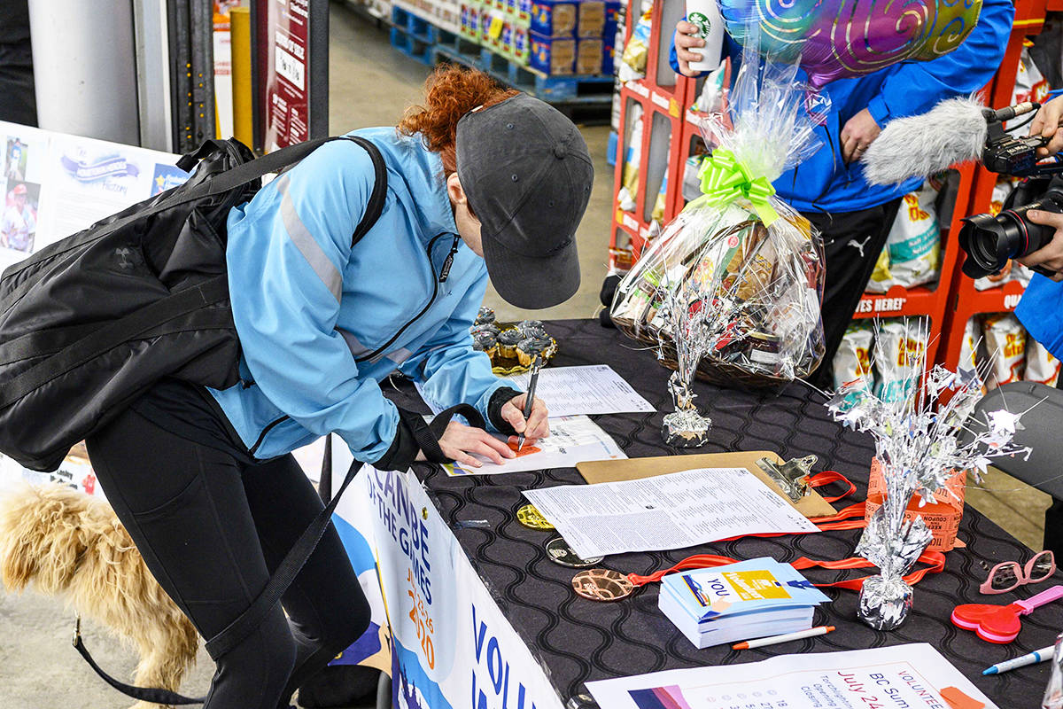 A volunteer signs up for the games in July. (Contributed photo)