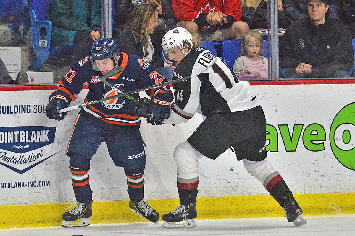 Giants player Eric Florchuk tangled with a Blazer Friday night (Jan. 31) in Western Hockey League action at Langley Events Centre (Gary Ahuja/special to Langley Advance Times)