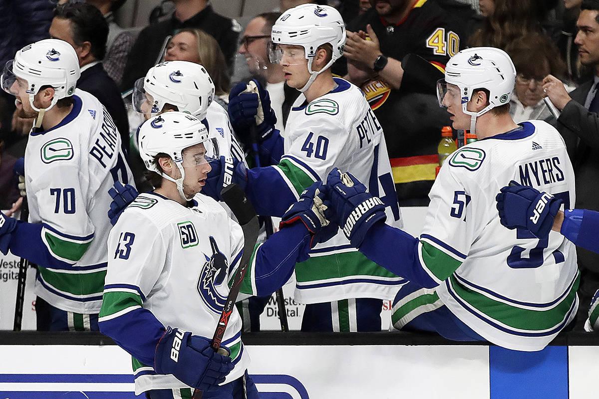 Vancouver Canucks' Quinn Hughes (43) is congratulated after scoring. (AP Photo/Ben Margot)