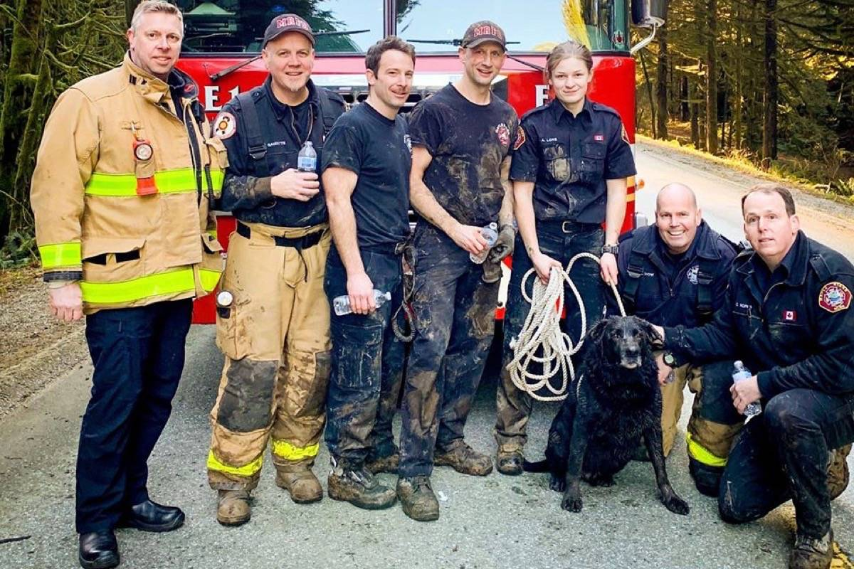 Maple Ridge firefighters pose with Corrado around 10 minutes after he was rescued. (Contributed)