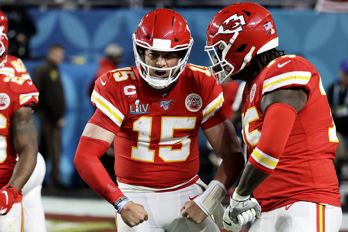 Kansas City Chiefs quarterback Patrick Mahomes (15) celebrates after scoring against the San Francisco 49ers during the first half of the NFL Super Bowl 54 football game Sunday, Feb. 2, 2020, in Miami Gardens, Fla. (AP Photo/Seth Wenig)
