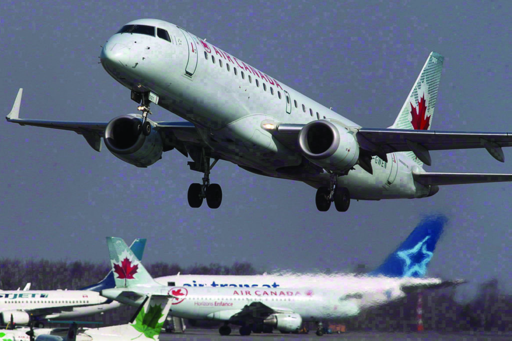 FILE – An Air Canada jet takes off from Halifax Stanfield International Airport in Enfield, N.S. on Thursday, March 8, 2012. THE CANADIAN PRESS/Andrew Vaughan