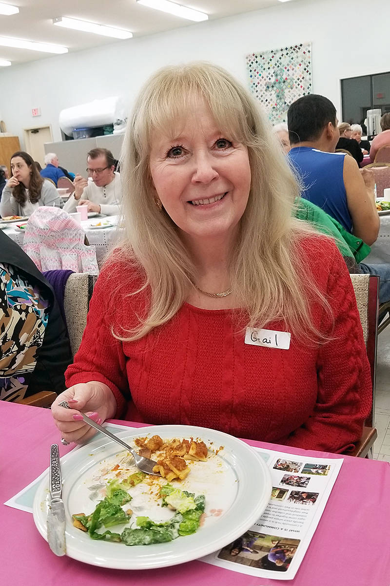 Gail Chaddock-Costello was at the One Table community dinner at the Shepherd of the Valley church in Langley on Saturday, (Feb. 1). It was the fourth dinner, and it attracted 68 people. (Dan Ferguson/Langley Advance Times)