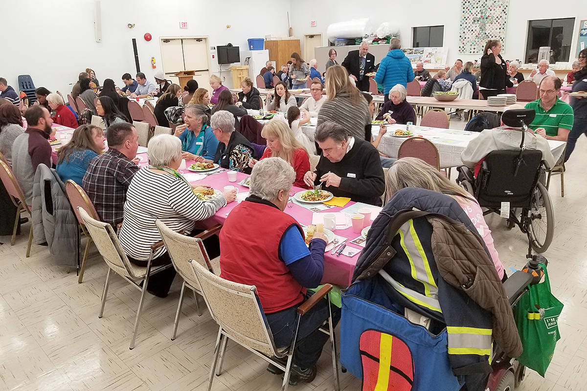 Saturday night (Feb. 1) marked the fourth One Table community dinner in Langley. Held at the Shepherd of the Valley church, it attracted 68 people. (Dan Ferguson/Langley Advance Times)