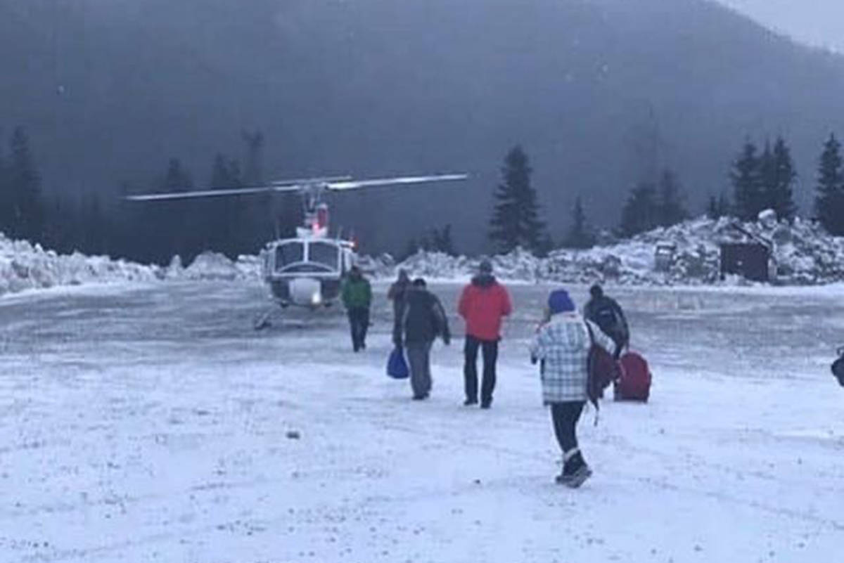 People stranded at the Sasquatch Mountain Resort line up for helicopter rides to Chilliwack after being stranded on top of the mountain by a landslide. (Vickie MacKenzie)