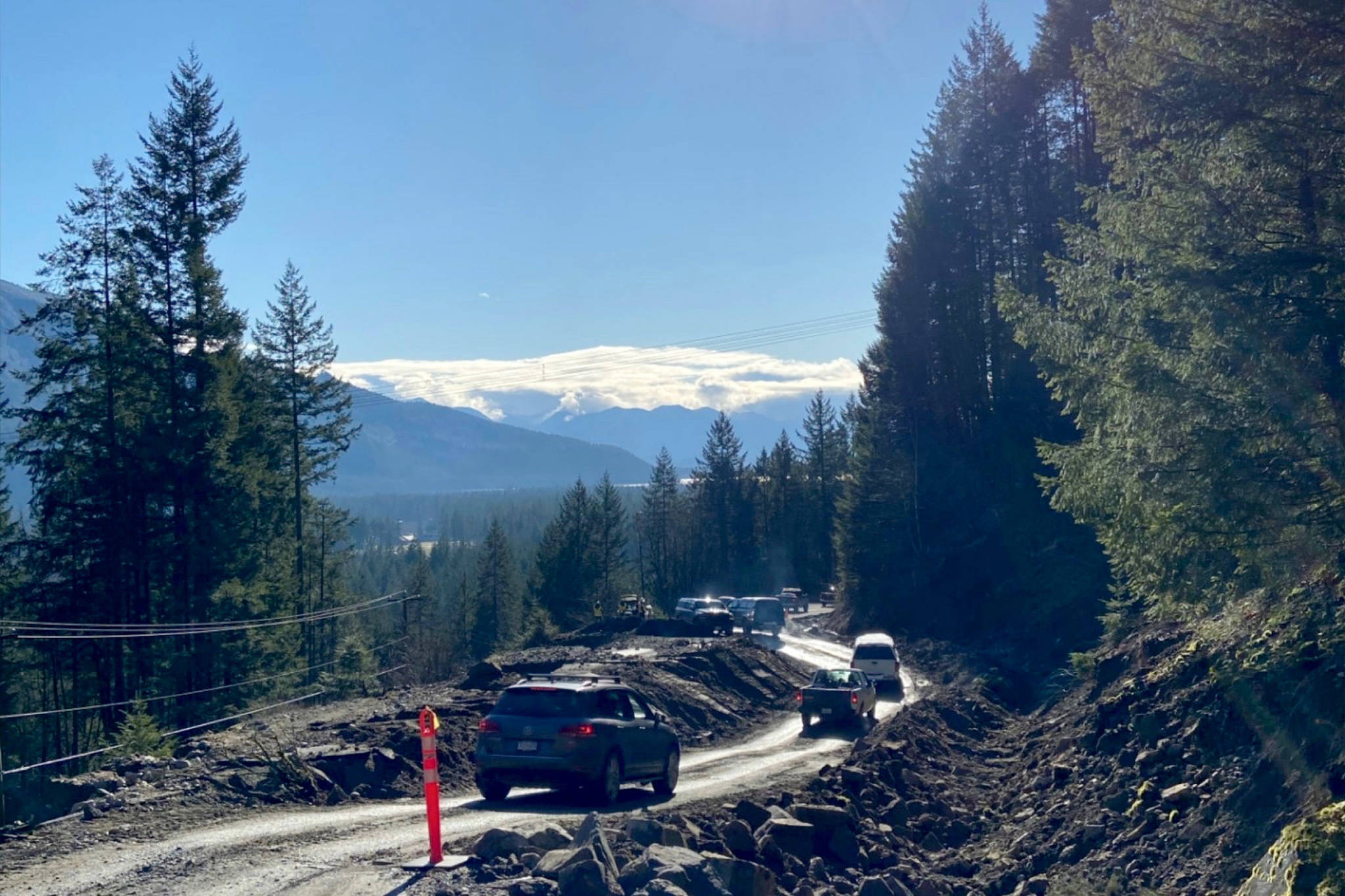 A convoy of vehicles leaves Hemlock Valley Road on Monday, escorted by an Emil Anderson Maintenance vehicle. Those staying at the resort have been stranded because of a landslide barring access to the road early this past weekend. (Emil Anderson Maintenance/Contributed)