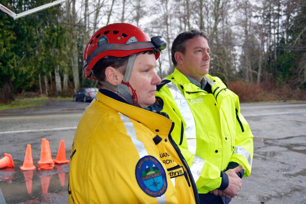 Juan de Fuca Search and Rescue manager Kathryn Farr and RCMP Cpl. Joe Holmes announce at a press conference that a body was discovered in the Sooke River on Tuesday. (Kevin Laird - Sooke News Mirror)