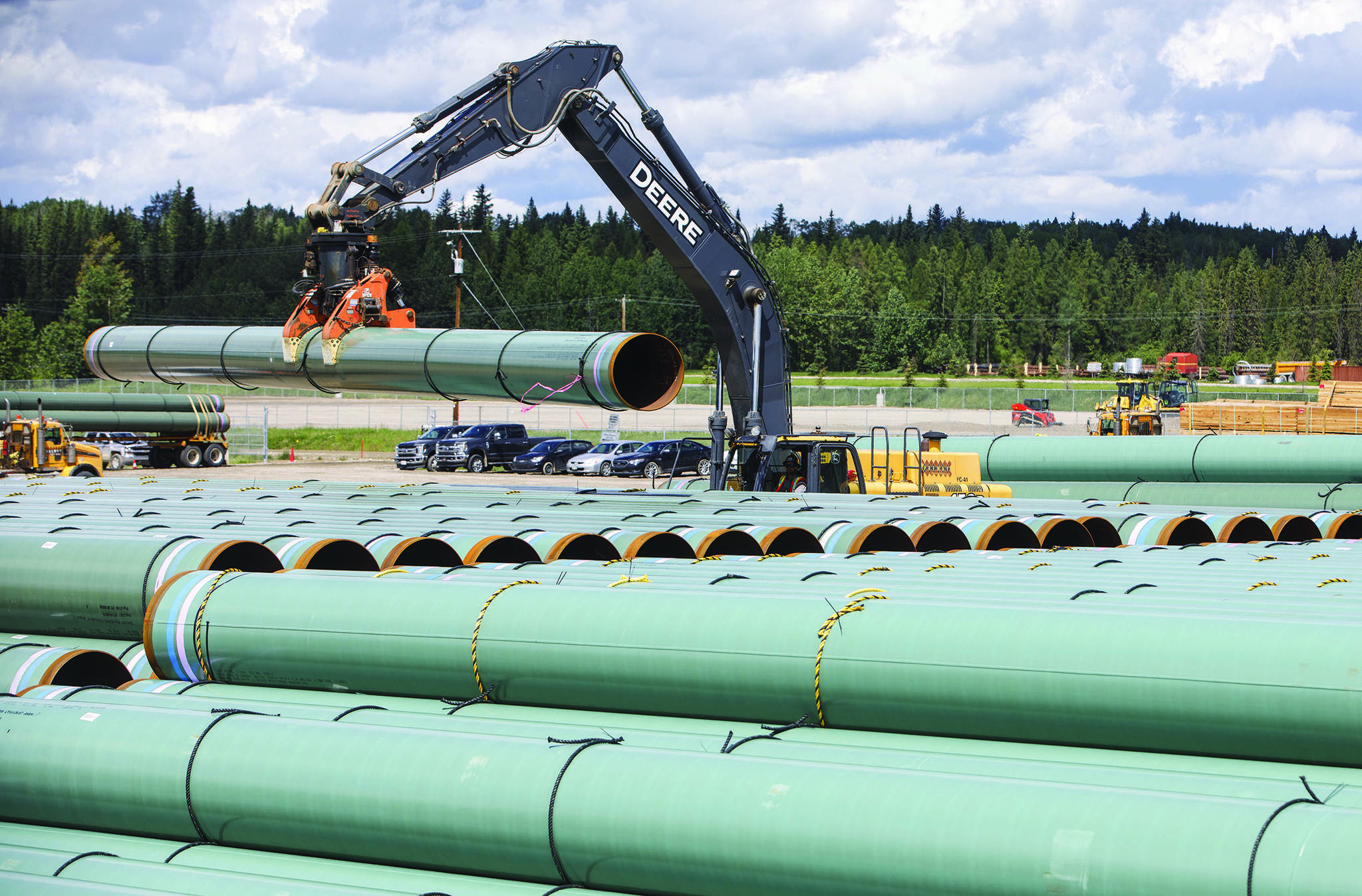 Pipe for the Trans Mountain pipeline is unloaded in Edson, Alta. on Tuesday June 18, 2019. The Federal Court of Appeal is set to release its decision on the latest challenge of the Trans Mountain pipeline expansion on Tuesday. THE CANADIAN PRESS/Jason Franson