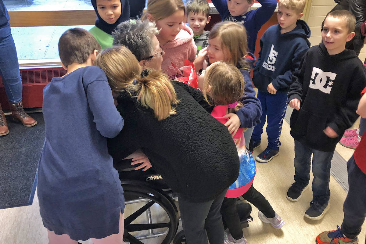 Aldergrove's Bella Howat, volunteer organizer for Shortreed Elementary's breakfast program, was swarmed with goodbye hugs from the students she served for the past six years. (Shortreed photo)