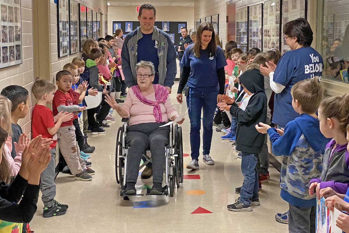 Bella Howatt was surprised by school hallways lined with applauding students and staff on Friday, bringing her to tears, following her last day feeding students – due to serious health concerns. (Shortreed Elementary photo)