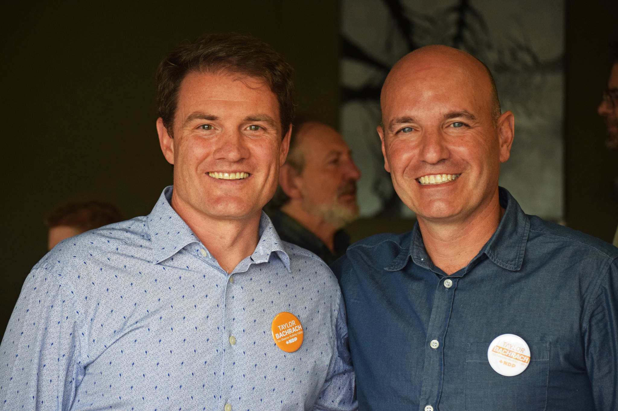 Taylor Bachrach (left) and Nathan Cullen (right) pictured at Bachrach's Smithers campaign office opening on Sept. 5. Bachrach is taking over Cullen's place as the NDP candidate for Skeena-Bulkley Valley. (Trevor Hewitt photo)