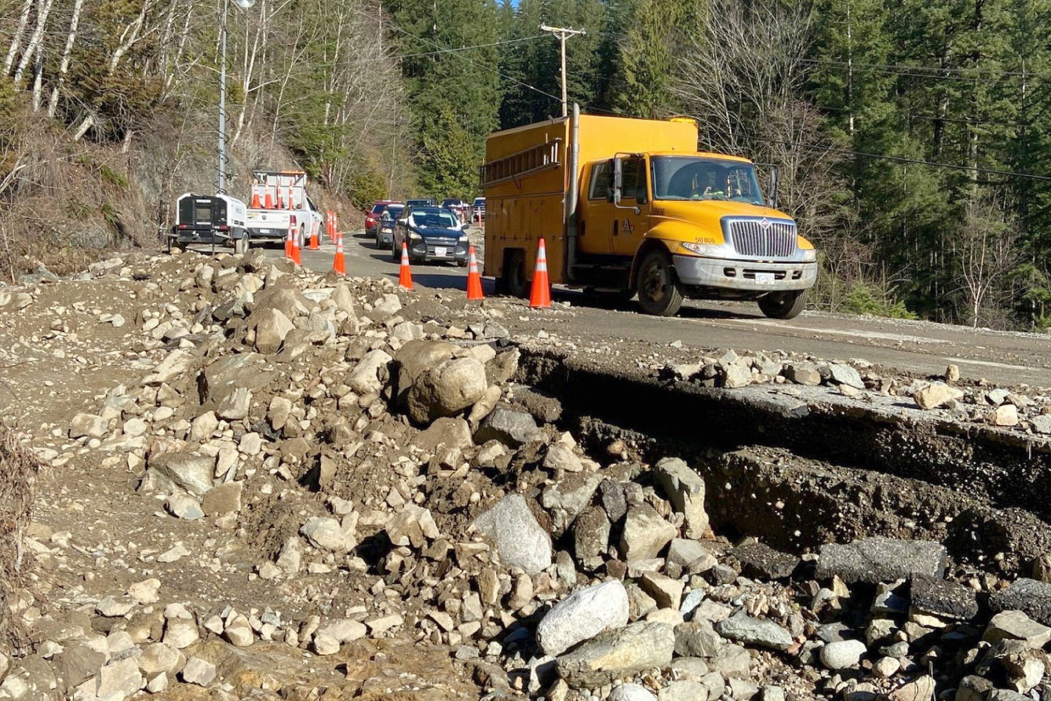 An escort truck from Emil Anderson Maintenance rolls ahead of a convoy of vehicles navigating the critically damaged Hemlock Valley Rd. on Feb. 3, 2020. (Emil Anderson Maintenance/Contributed)