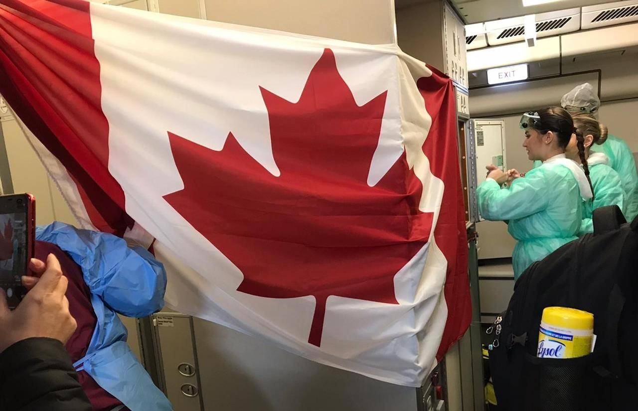 A Canadian flag is hung up as people board a plane destined for Canada at the Wuhan Tianhe International Airport early in the morning on Friday, Feb. 7, 2020 in this handout photo provided by Myriam Larouche. THE CANADIAN PRESS/HO, Myriam Larouche