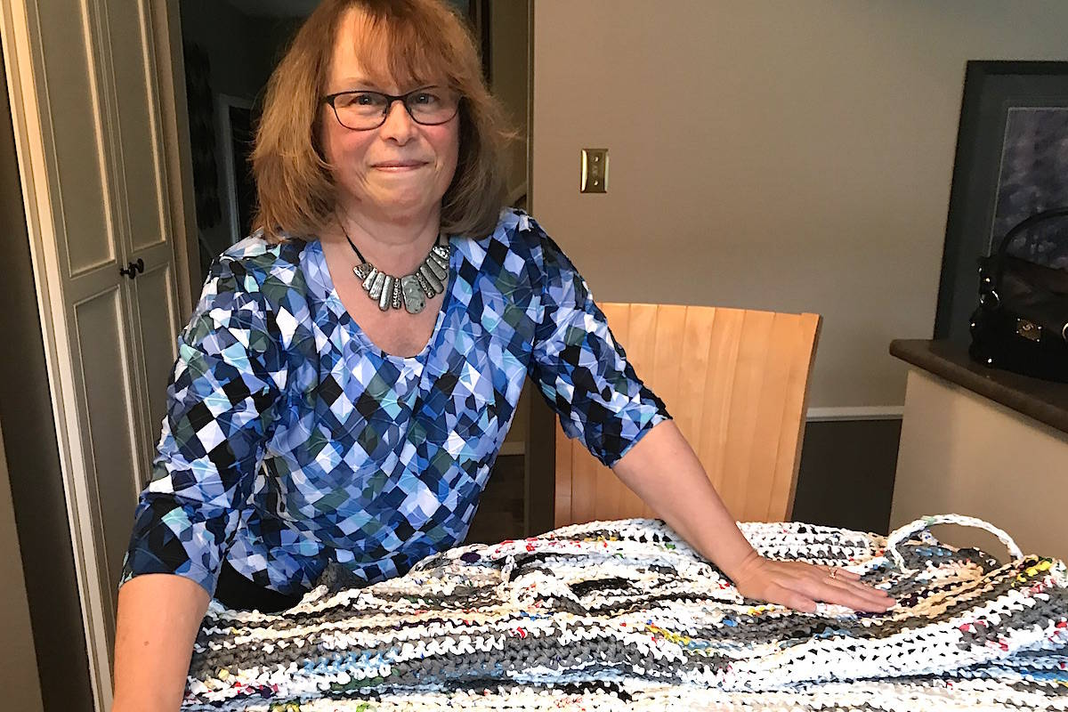 Judy Simmill and one of her crocheted sleeping mats made from plastic bags. (Jennifer Feinberg/ The Progress)