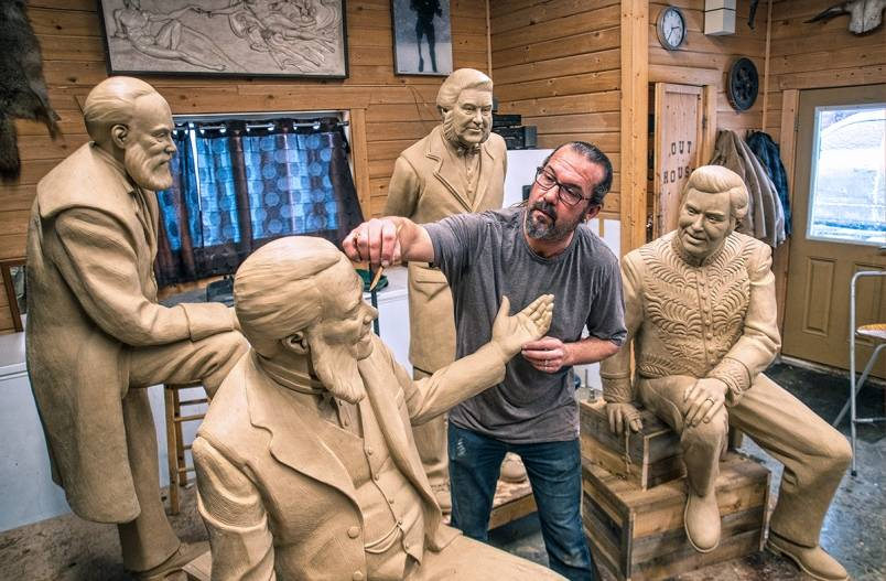 Sculptor Nathan Scott adds detail to the tremendous clay mutton chops of John Abbott. Looking on is the ill-fated John Thompson (front right), the 68-day leader Charles Tupper (back right) and Mackenzie Bowell (back left). (Dave Eagles/Kamloops This Week)