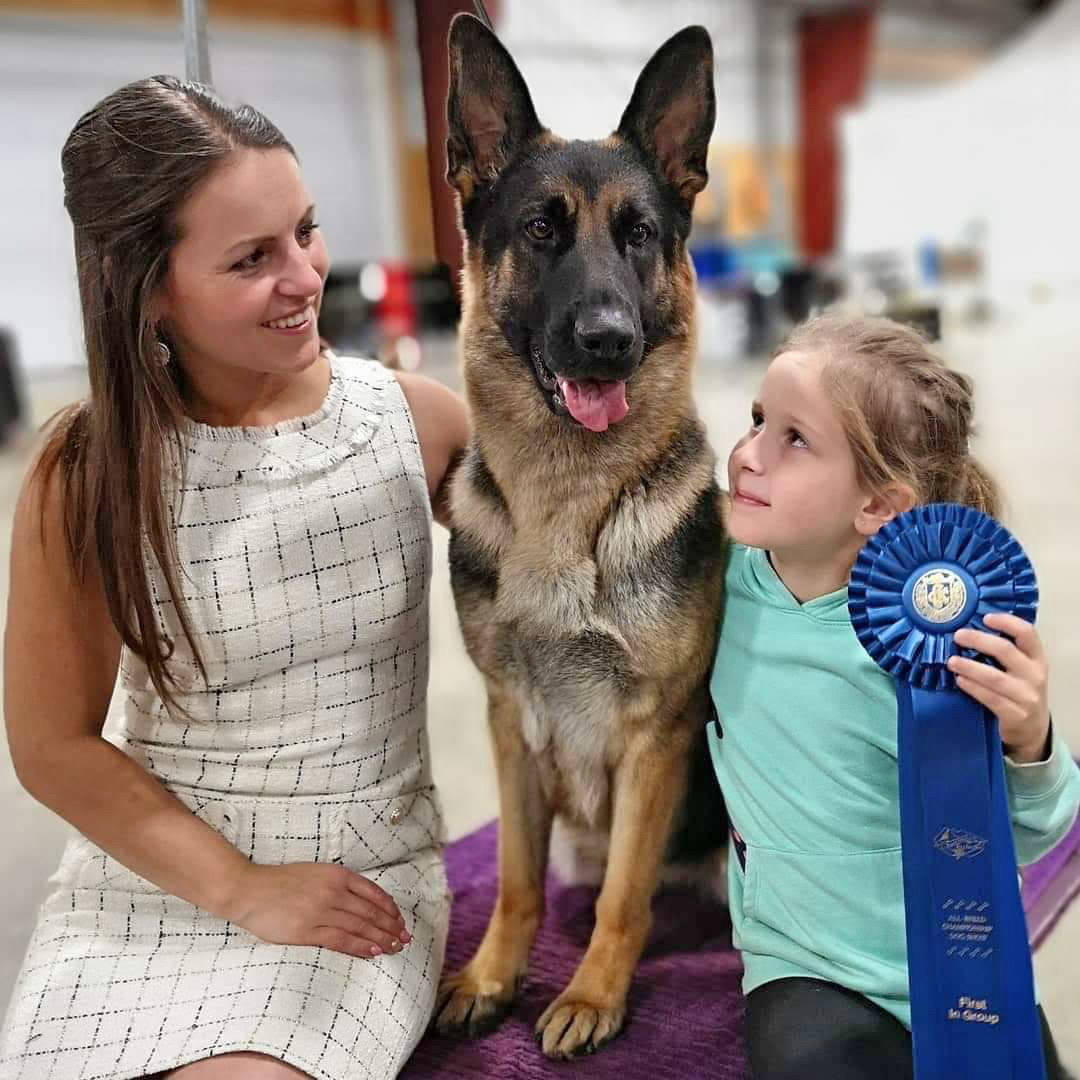 Bella the German shepherd and handler Courtney Penner (seen here with seven-year-old Parker Duin) are in New York City competing in the Westminster Kennel Club Dog Show which runs Feb. 9 to Feb. 11. (Jody Duin)