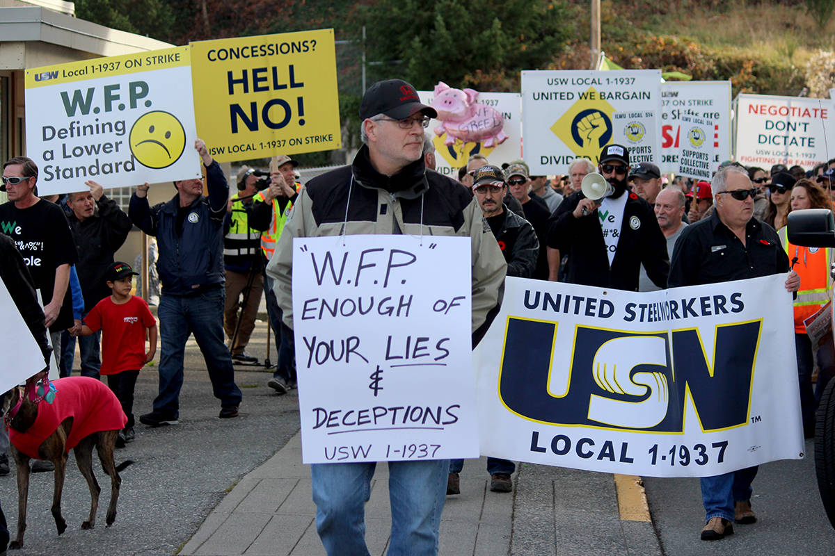 Western Forest Products and United Steelworkers Local 1-1937 have reached a tentative agreement to end a more than seven-month-long strike. Pictured here, workers during a rally in Nanaimo on Nov. 6, 2019. (Black Press File Photo)