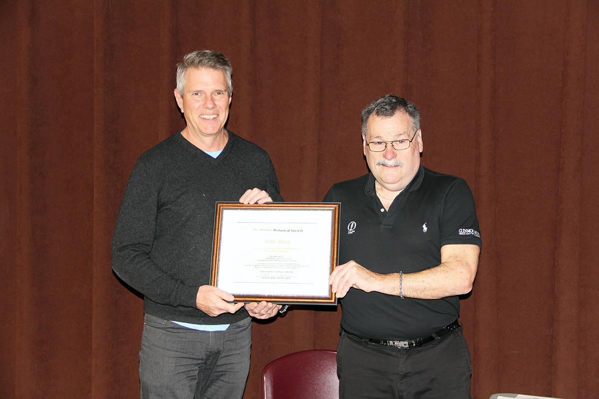 Surrey Historical Society president Michael Gibbs awards former MP John Aldag with a certificate of appreciation. (Photo: Malin Jordan)