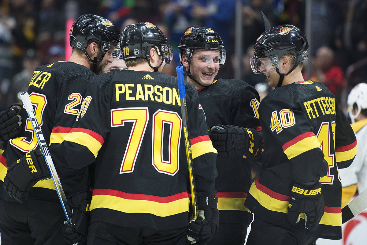 Vancouver Canucks centre Elias Pettersson (40) celebrates his goal with his teammates during second period NHL action in Vancouver, Monday, February 10, 2020. THE CANADIAN PRESS/Jonathan Hayward