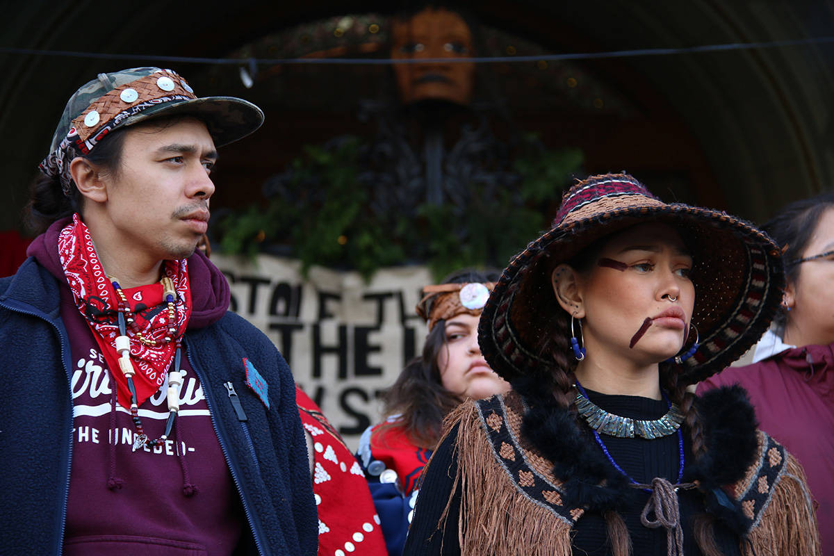 Kolin Sutherland-Wilson and Sii-am Hamilton address the hundreds of people outside the B.C. Legislature. (Kendra Crighton/News Staff)
