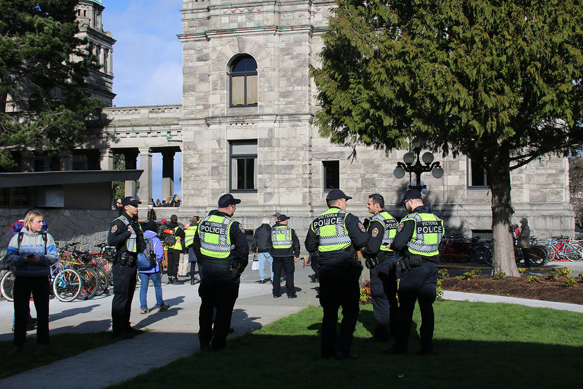 A group of Victoria police officers stand by as supporters block entrances to the B.C. Legislature. (Kendra Crighton/News Staff)