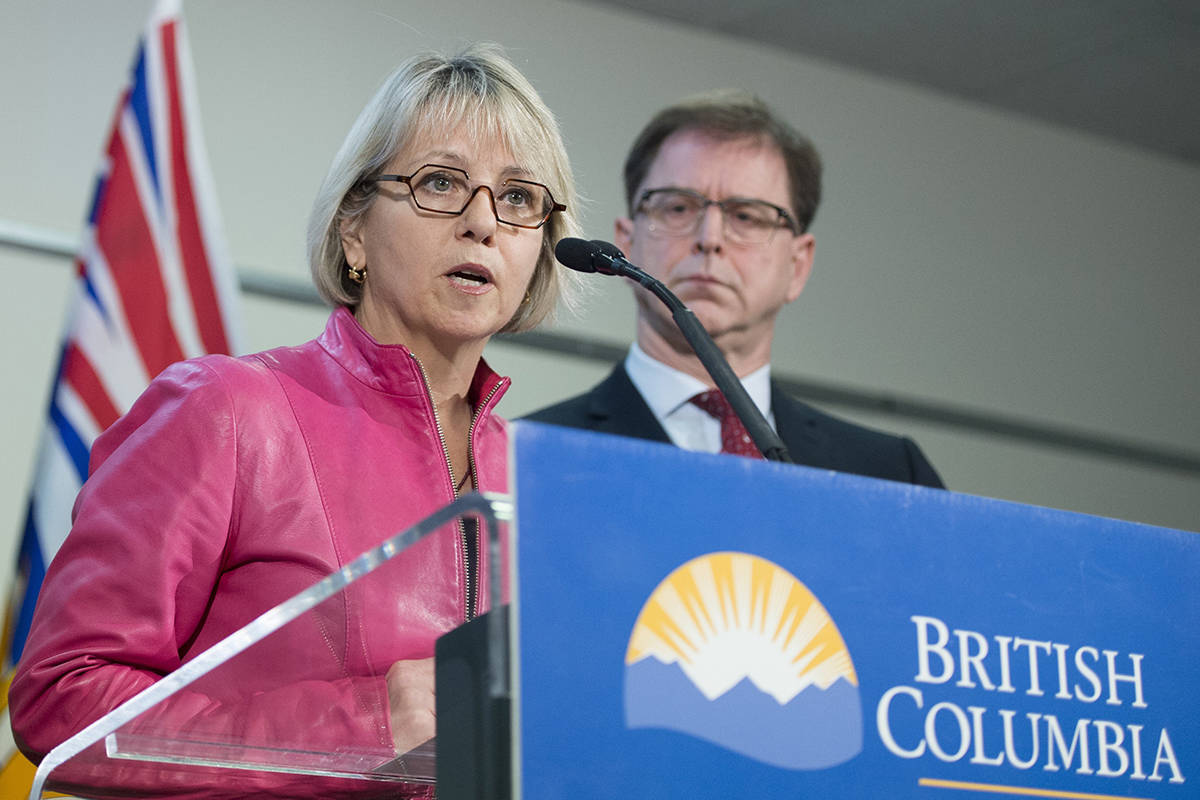 FILE – British Columbia Health Minister Adrian Dix looks on as Provincial Health Officer Dr. Bonnie Henry addresses the media during a news conference at the BC Centre of Disease Control in Vancouver B.C, Tuesday, January 28, 2020.THE CANADIAN PRESS/Jonathan Hayward