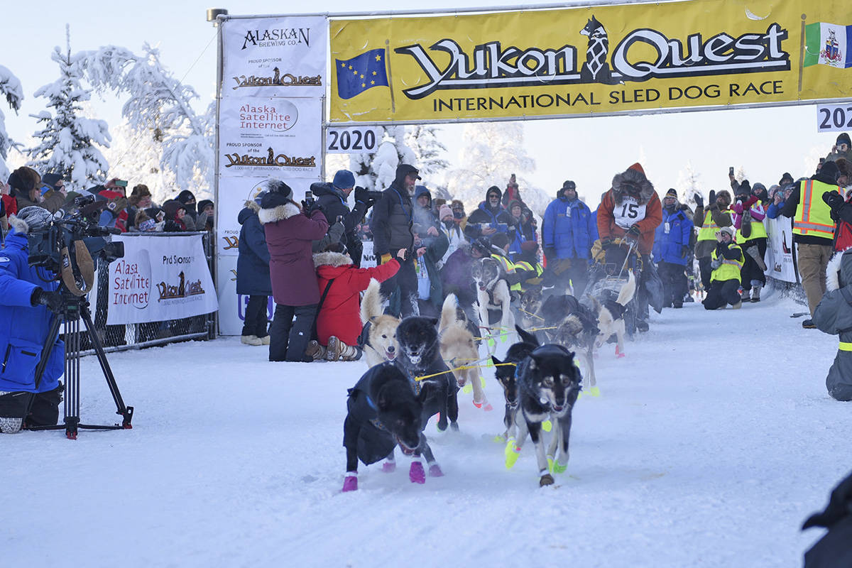 Brent Sass's team digs in to start the 2020 Yukon Quest at the Morris Thompson Cultural and Visitors Center in Fairbanks, Alaska, on Feb. 1. (John Hopkins-Hill/Yukon News file)
