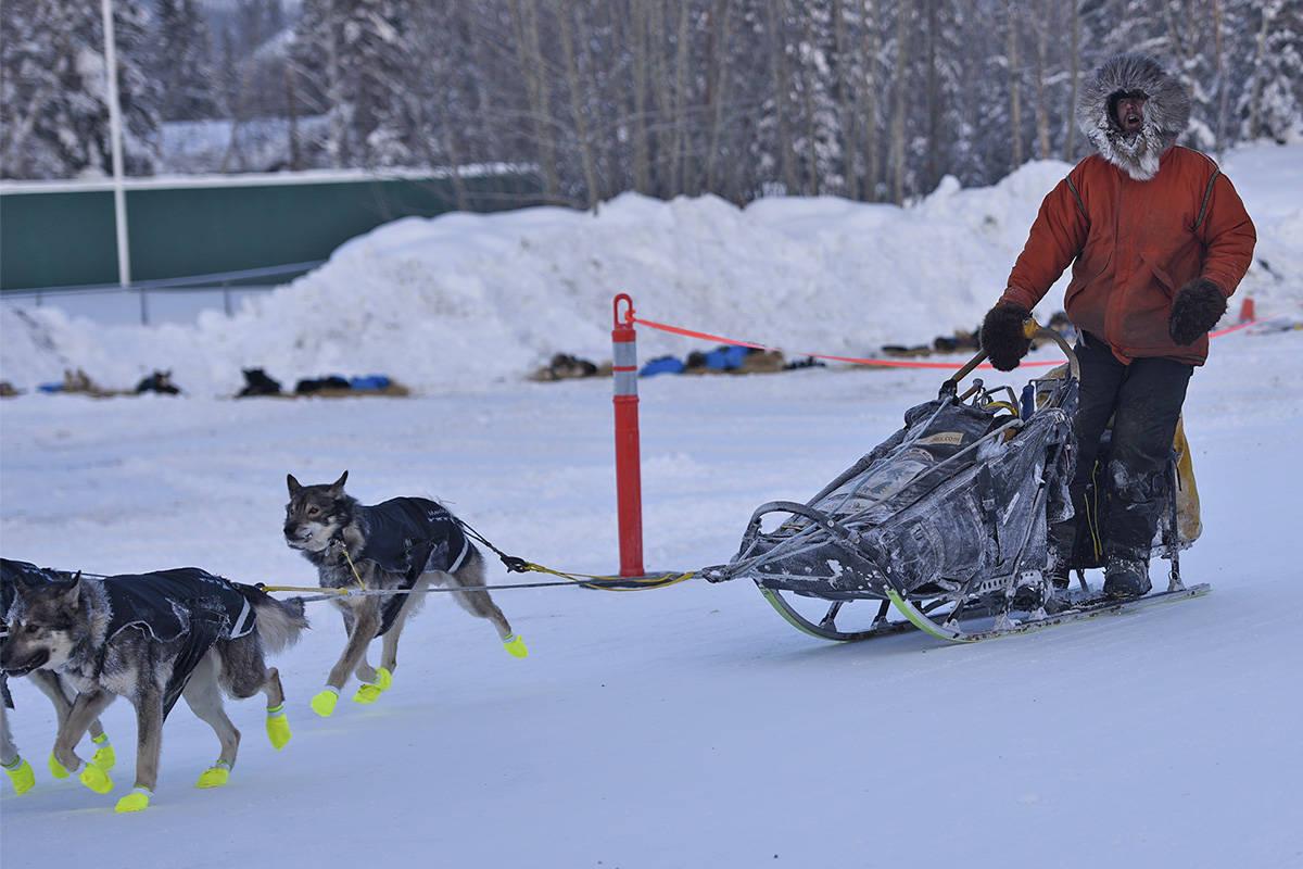 Brent Sass and his team leave the Pelly Crossing checkpoint on Feb. 9 during the 2020 Yukon Quest. (John Hopkins-Hill/Yukon News file)