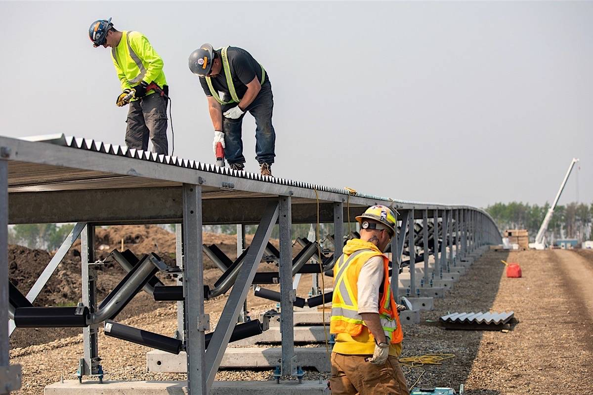 FILE – Contract employees build soil conveyor for Site C dam in northeast B.C., spring 2019. (B.C. Hydro)