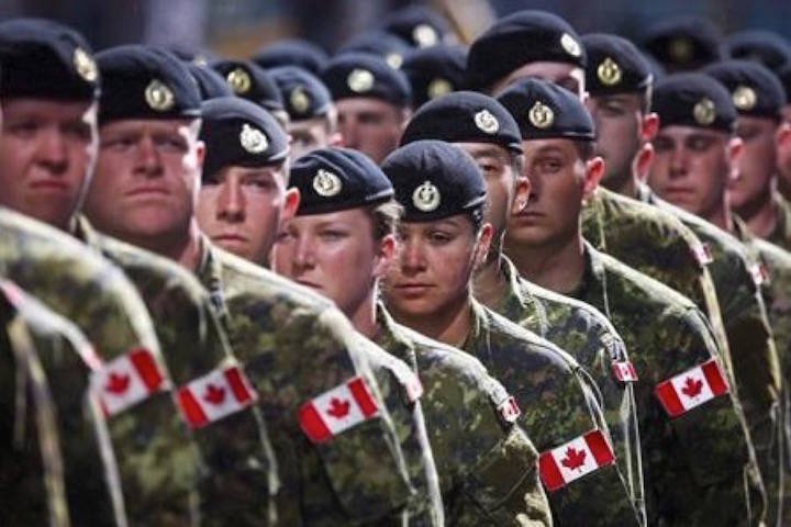 Members of the Canadian Armed Forces march during the Calgary Stampede parade in 2016. (Jeff McIntosh/ The Canadian Press)