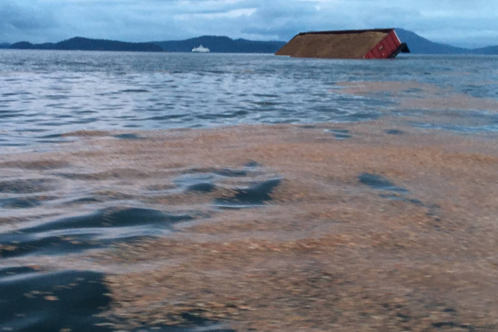 Wood chips float in the Salish Sea between Pender and Saltspring Islands on Wednesday morning. (Ian Hinkle Twitter)                                Wood chips float in the Salish Sea between Pender and Saltspring Islands on Wednesday morning. (Ian Hinkle Twitter)