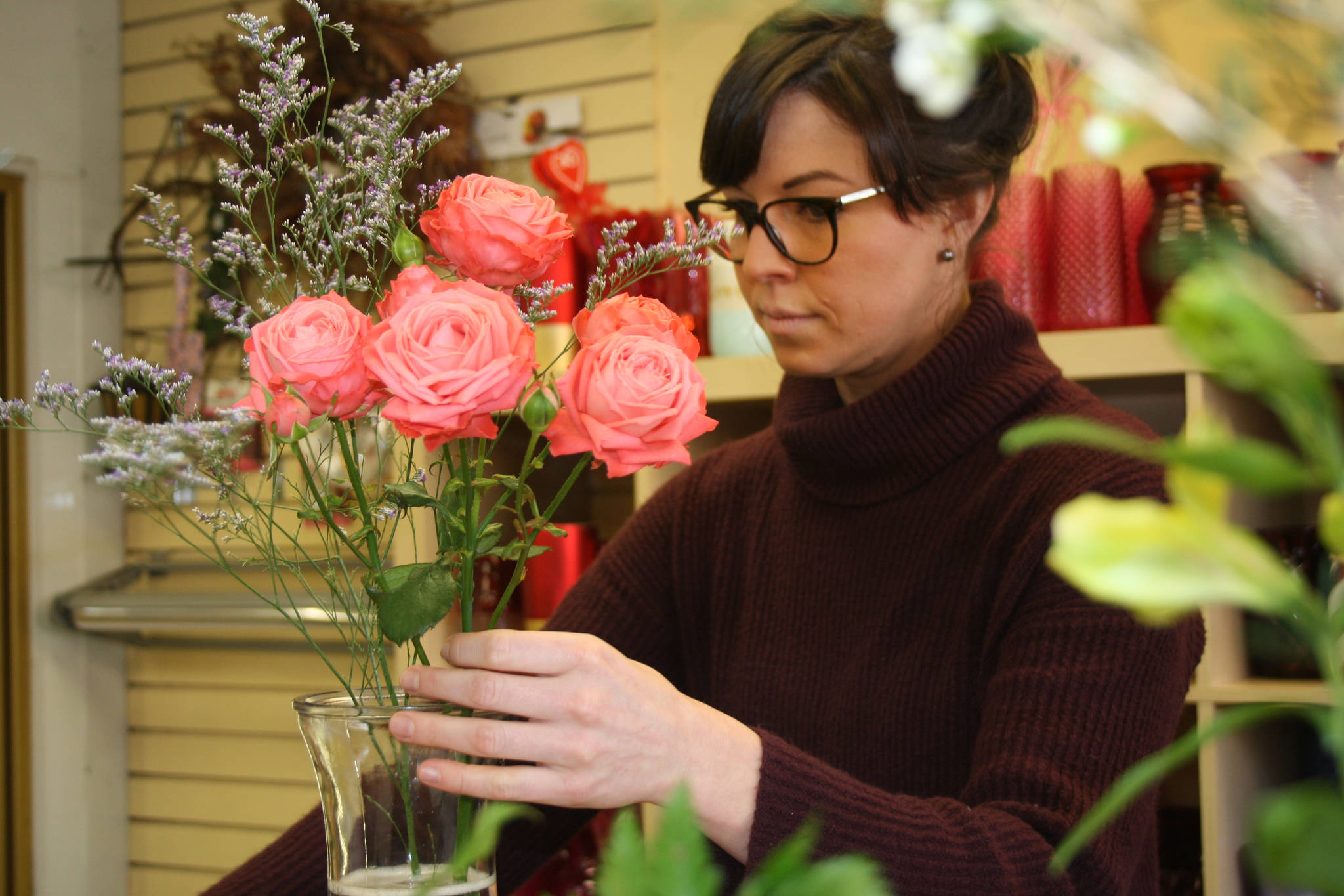 Ashley Beck returns to the Oak Bay Flower Shop twice a year, at Valentine's and Mother's days. On Feb. 13 and 14 there ends up being very little room to work at Oak Bay Flower Shop as customers, mostly men but of all demographics, flock to the shop. (Travis Paterson/News Staff)