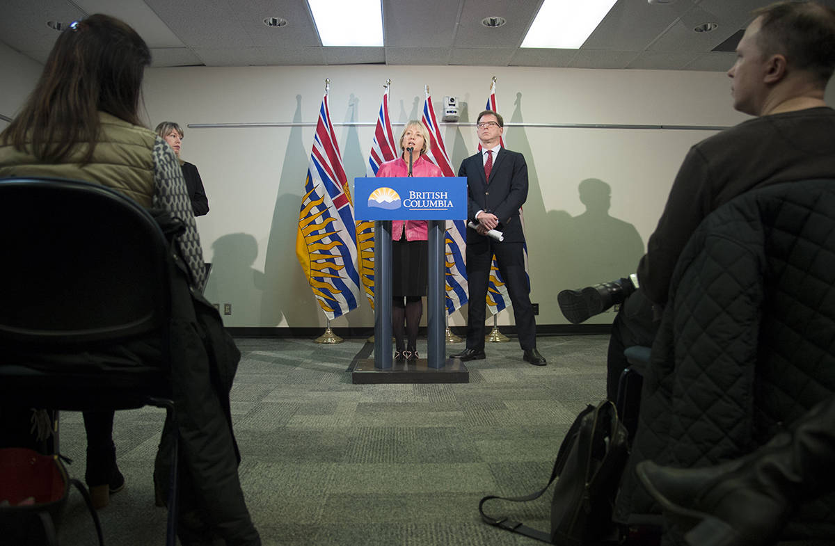 British Columbia Health Minister Adrian Dix looks on as Provincial Health Officer Dr. Bonnie Henry addresses the media during a news conference at the BC Centre of Disease Control in Vancouver B.C, Tuesday, January 28, 2020. (THE CANADIAN PRESS/Jonathan Hayward)
