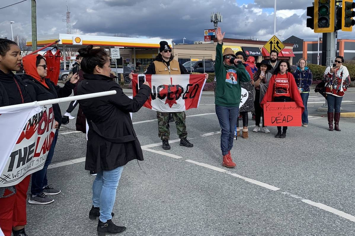 Sto:lo artist and activist Carrielynn Victor speaks at the blocked intersection of Luckakuck Way and Vedder Road after 1 p.m. on Feb. 14, 2020 at the Sto:lo day of action protest in solidarity with the Wet'suwet'en hereditary chiefs. (Paul Henderson/ The Progress)