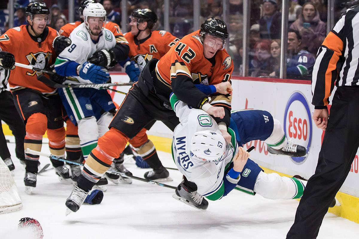 Anaheim Ducks' Josh Manson (42) punches Vancouver Canucks' Tyler Myers (57) during the second period of an NHL hockey game in Vancouver, on Sunday, Feb. 16, 2020. THE CANADIAN PRESS/Darryl Dyck