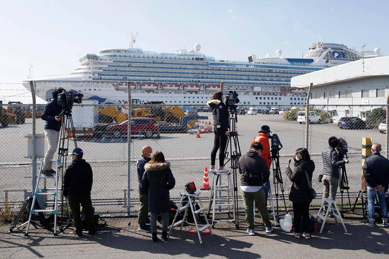 Videographers film the quarantined Diamond Princess cruise ship Saturday, Feb. 15, 2020, in Yokohama, near Tokyo. A viral outbreak that began in China has infected more than 67,000 people globally. The World Health Organization has named the illness COVID-19, referring to its origin late last year and the coronavirus that causes it. (AP Photo/Jae C. Hong)