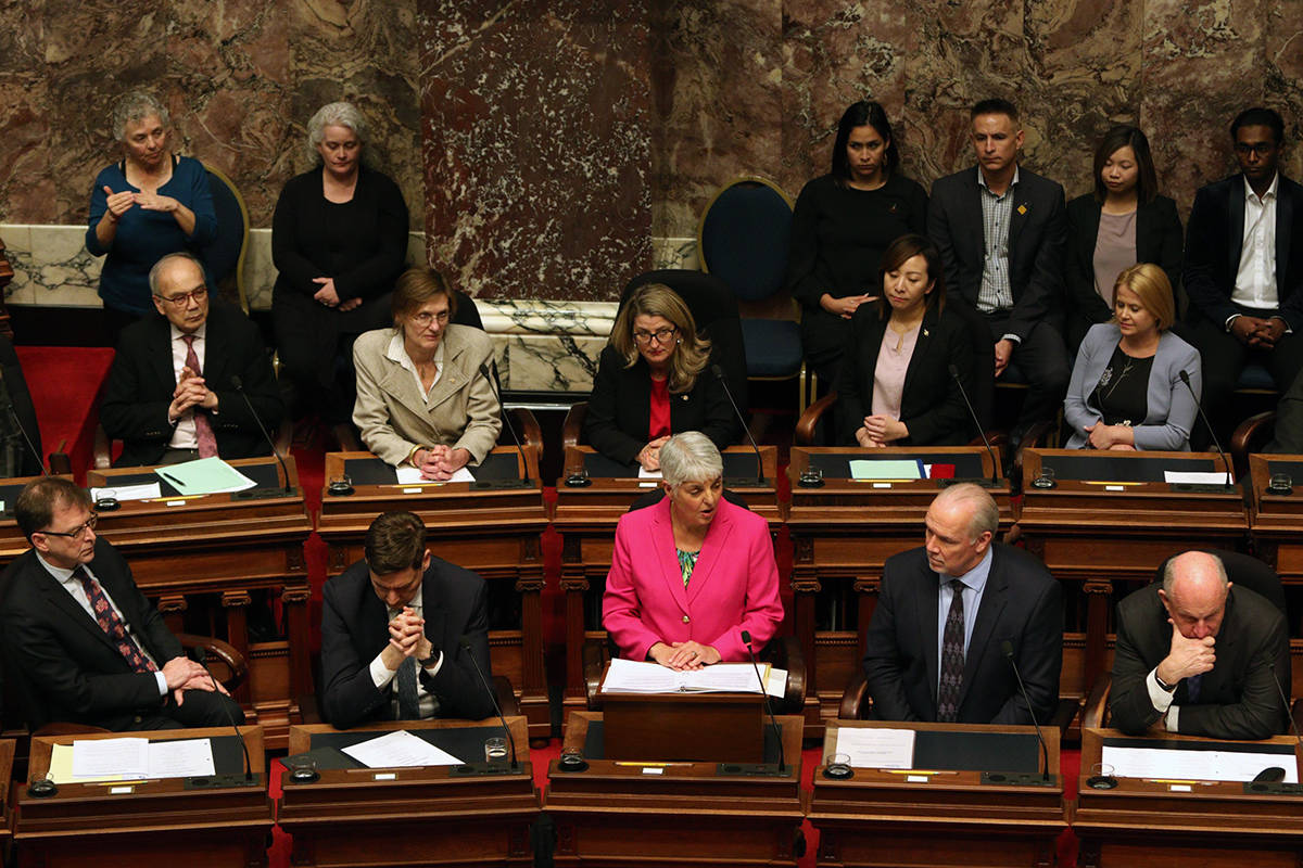 Minister of Finance Carole James delivers the budget speech from the legislative assembly at B.C. Legislature in Victoria, B.C., on Tuesday, February 18, 2020. THE CANADIAN PRESS/Chad Hipolito