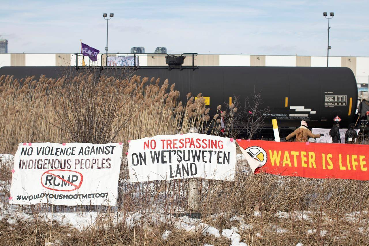 Banners hang on a fence as protesters stage a blockade of the rail line at Macmillan Yard in Toronto, Saturday, Feb. 15, 2020. The protest is in solidarity with the Wet'suwet'en hereditary chiefs opposed to the LNG pipeline in northern British Columbia. THE CANADIAN PRESS/Chris Young